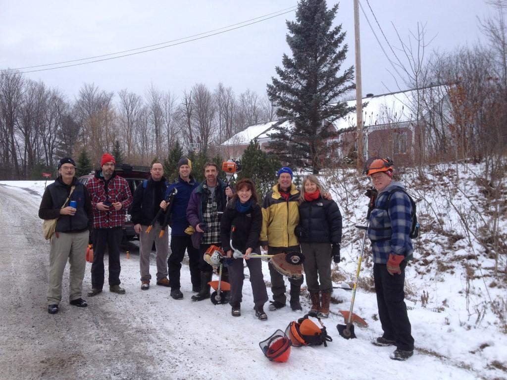 large group of people volunteering in the winter